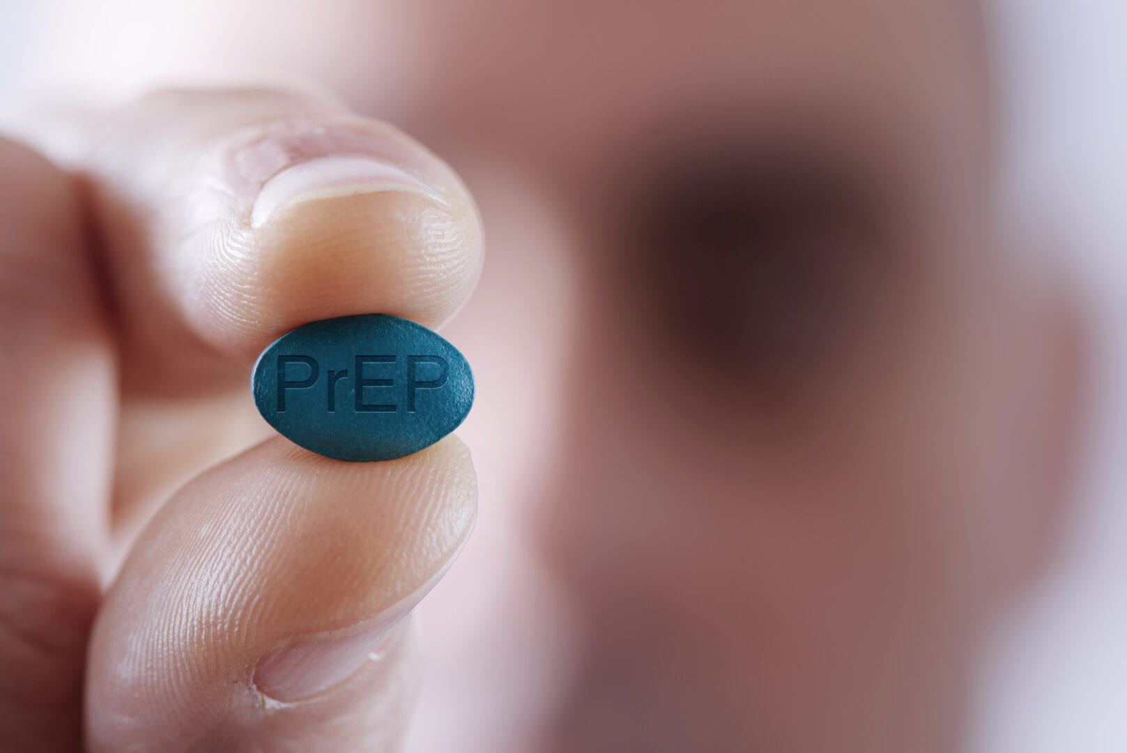 young man with a PrEP pill